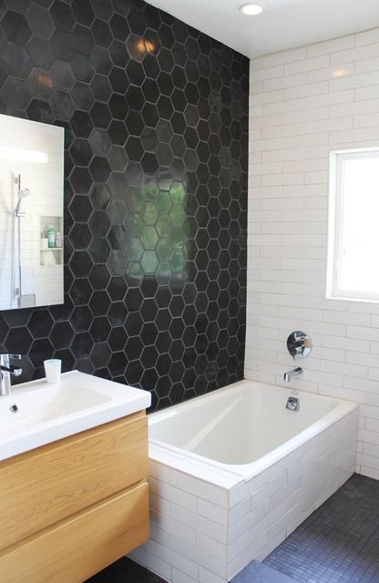 black honeycomb tiles on the wall