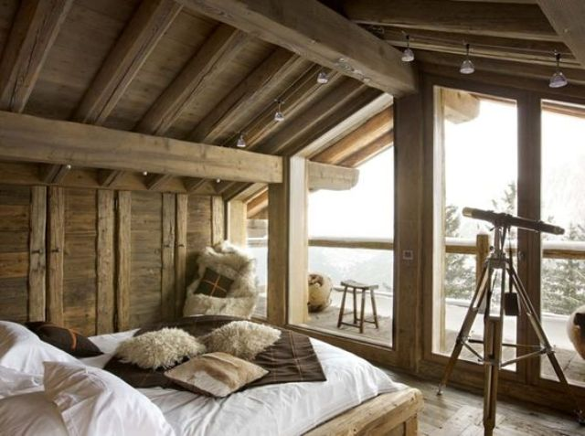 chalet bedroom with track lights to make the space illuminated
