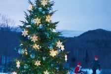24 outdoor Christmas tree with light snowflakes and oversized blue ornaments