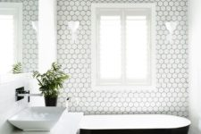 25 dark grey floors, a dark ceiling and white hex tiles with black grout to tie everything up