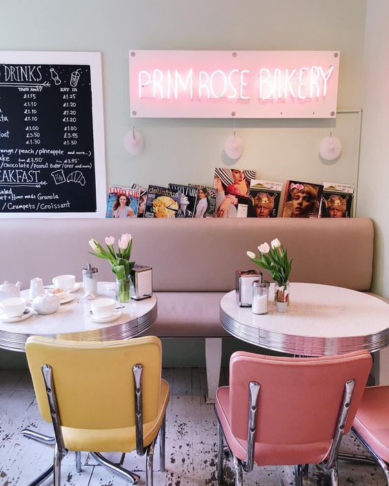 mid-century modern coffee shop in pink and yellow