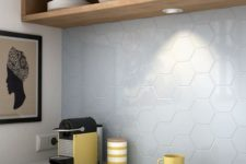 25 pale blue hex tiles contrast with warm wood furniture