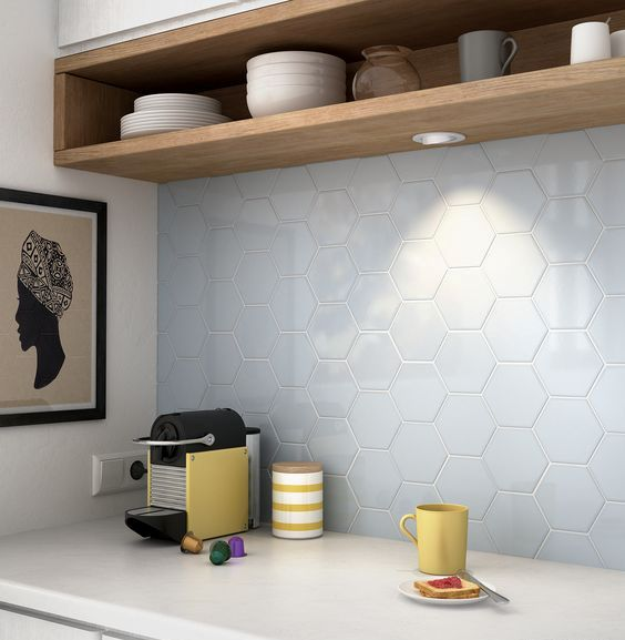 pale blue hex tiles contrast with warm wood furniture