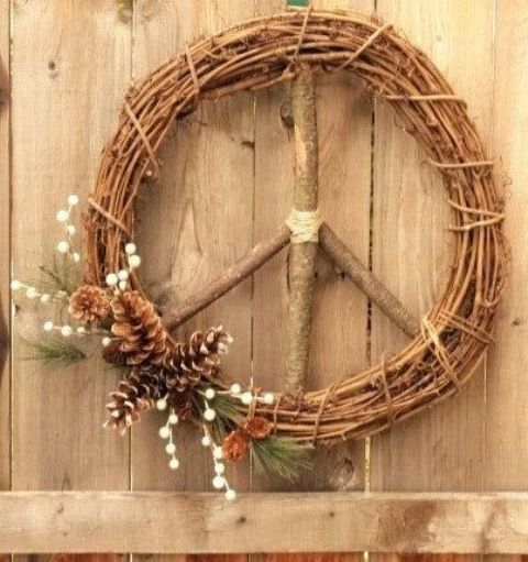 vine Christmas wreath styled as a peace sign