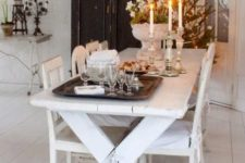 25 whitewashed picnic table and chairs, a contrasting black wardrobe