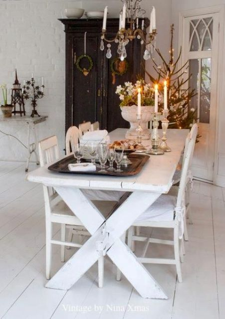 whitewashed picnic table and chairs, a contrasting black wardrobe