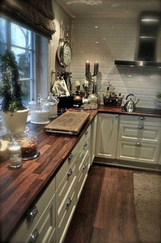 wooden tiles echo with floors, looks great with subway tiles backsplash and add warmth to the kitchen