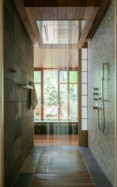 East-inspired walk-in shower with wooden floor and a rain shower