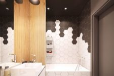 26 black and white honeycomb tile mosaics in the bathtub zone