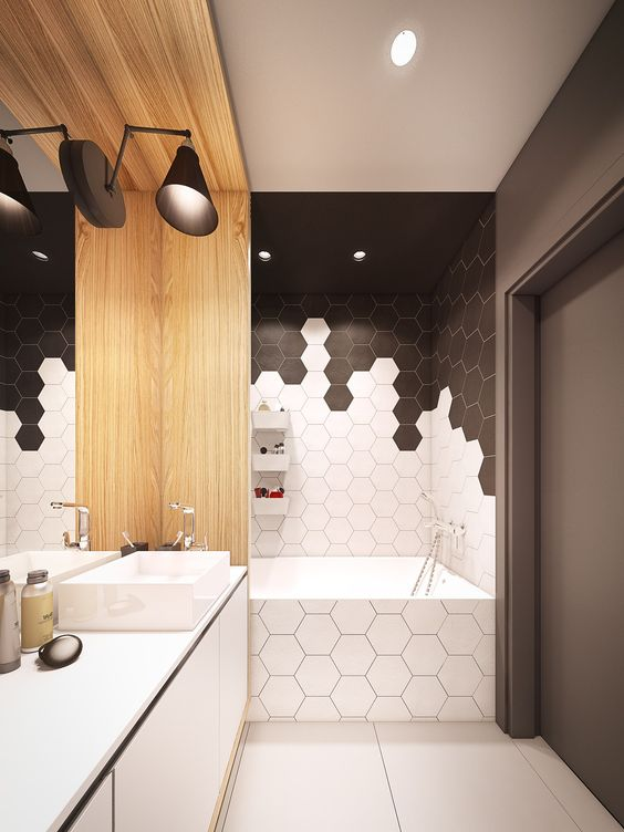 black and white honeycomb tile mosaics in the bathtub zone