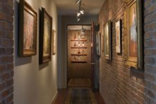 26 industrial hallway with artworks that are highlighted with track lights