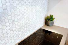 26 neutral mother of pearl hex tile backsplash for a modern kitchen