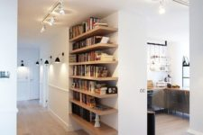 27 modern hallway and a bookshelf accentuated with lights