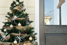 27 rustic tree decor with a basket, gold ornaments and burlap deco  mesh