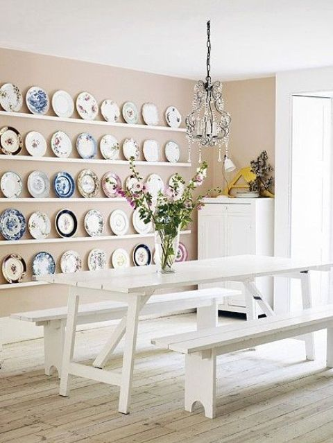 White Picnic Furniture And Colorful Platters On The Wall