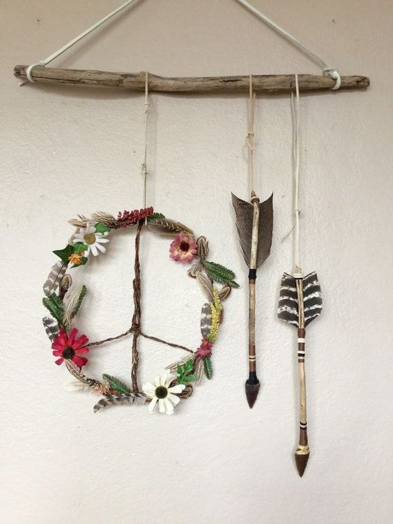 boho wildflowers peace wreath and arrows hanging
