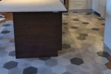 29 hardwood floors and grey mosaic hex tiles to separate a kitchen zone and a dining zone
