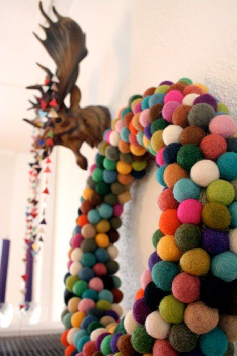 colorful felt balls combing to make the cutest wreath
