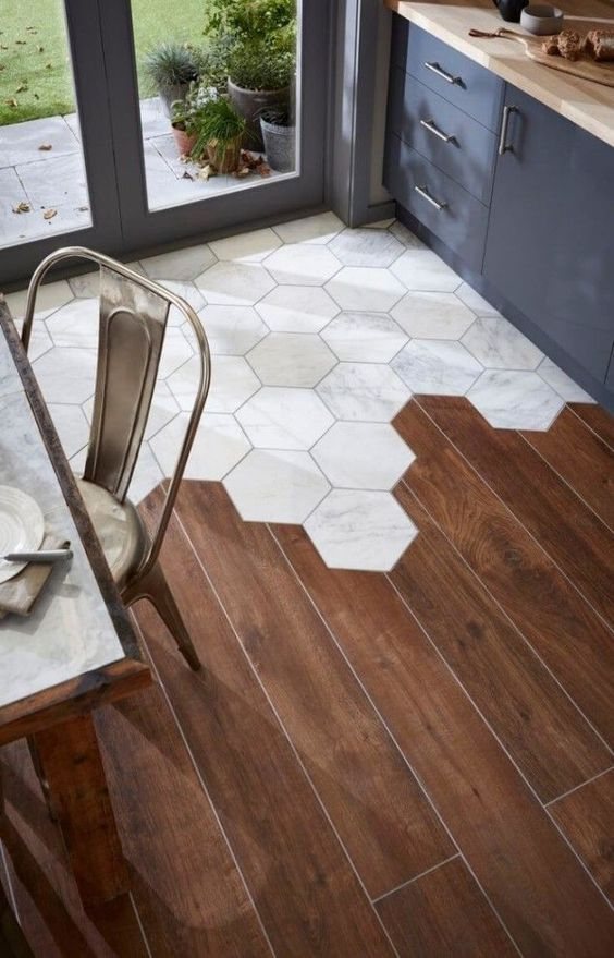 hardwood floors combines with hex tiles are an eye-catching design feature