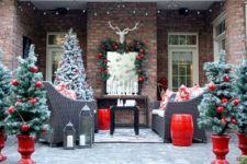 30 snowy faux trees with large glossy red ornaments