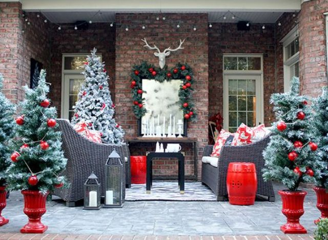 snowy faux trees with large glossy red ornaments