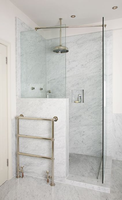 stylish small marble shower with a half wall and glass