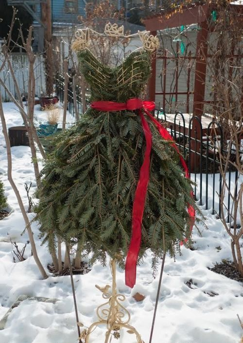 31 Christmas tree shaped as a lady's dress with a red sash