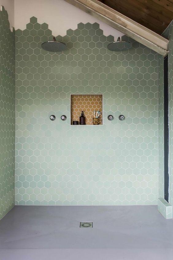 green shower hexagonal tiles towards the ceiling