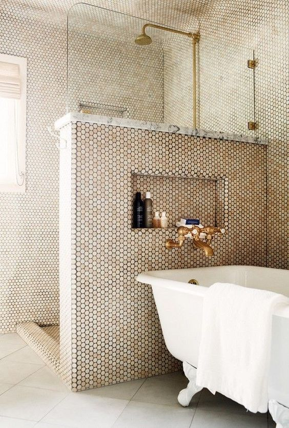 penny tiles cover the whole bathroom and shower a half wall keeps the