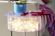 31 small IKEA table with string lights inside is totally DIYable