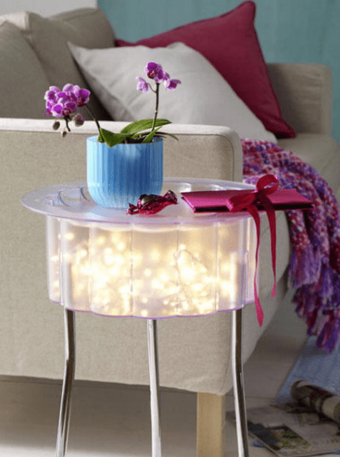 small IKEA table with string lights inside is totally DIYable