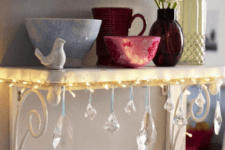 32 attach string lights and crystals to a small shelf