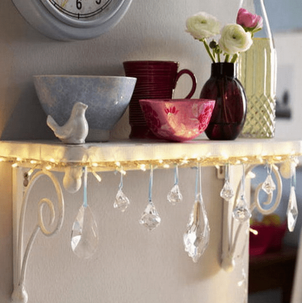 attach string lights and crystals to a small shelf