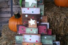 32 colorful pallet trees decorated with stars and buttons