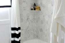 32 grey marble hex tiles over the bathtub