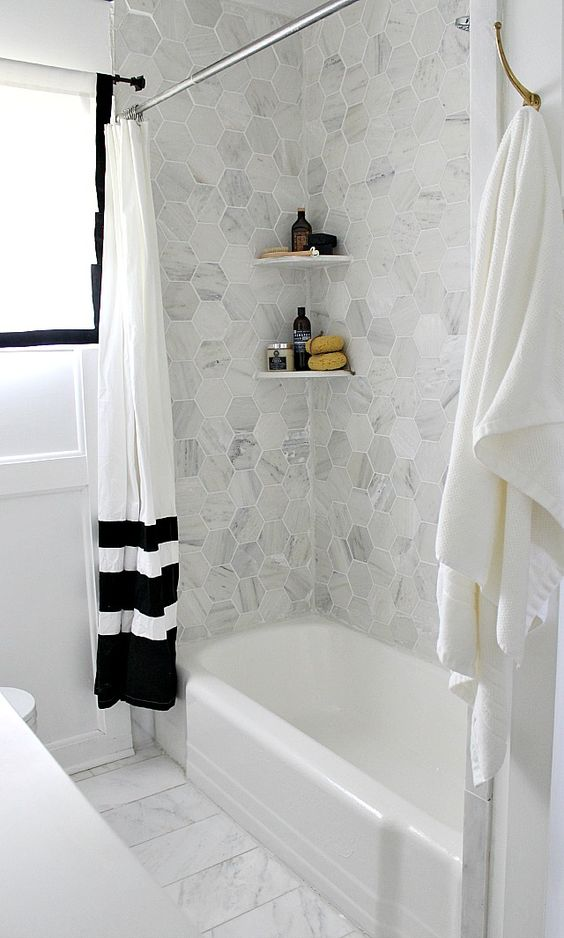 Grey Marble Hex Tiles Over The Bathtub