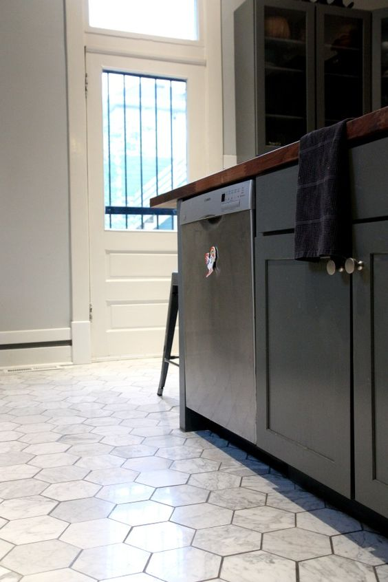 marble hex tile floors make black cabinets stand out