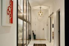32 track lighting featuring artwork in the hallway