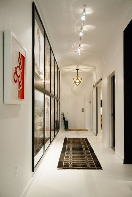 32 cool and functional track lighting ideas digsdigs track lighting featuring artwork in the hallway aloadofball Images