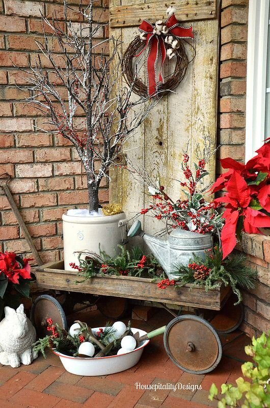 vintage cart with watering cans, pots and evergreens