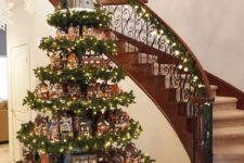 33 gingerbread houses on stands covered with evergreens and garlands