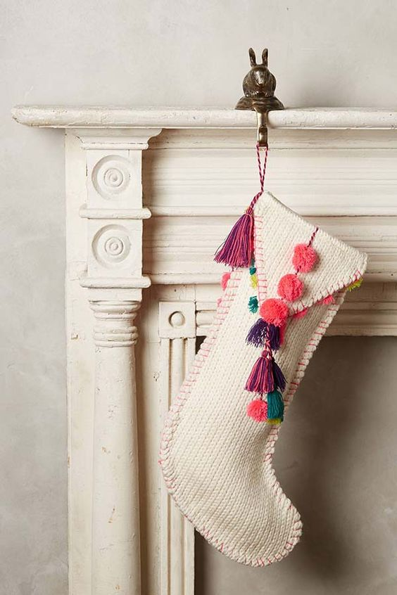 knit stocking with colorful pompoms