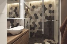 33 shower area with black, grey and white hex tile mosaic
