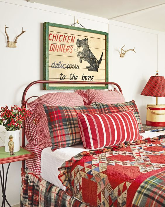 vintage Christmas bedroom decor with red bedding, berries and a pallet sign