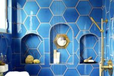 34 bold blue hexagon tiles with niches in the shower