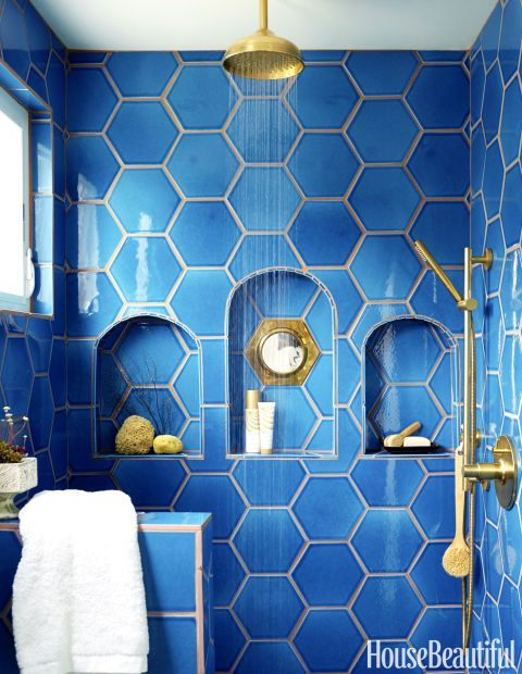 bold blue hexagon tiles with niches in the shower