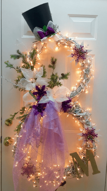 lit up snowman wreath with a monogram and tulle