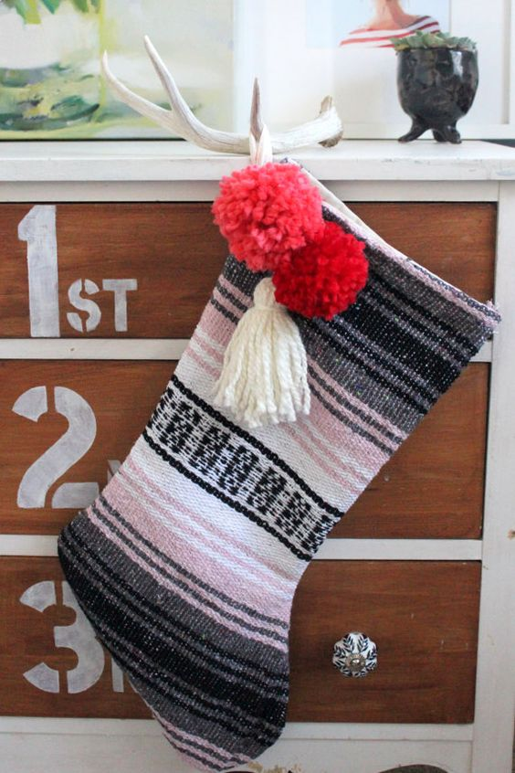 blanket stocking with pompoms