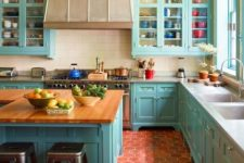 35 red hex tile floors contrast with turquoise cabinets