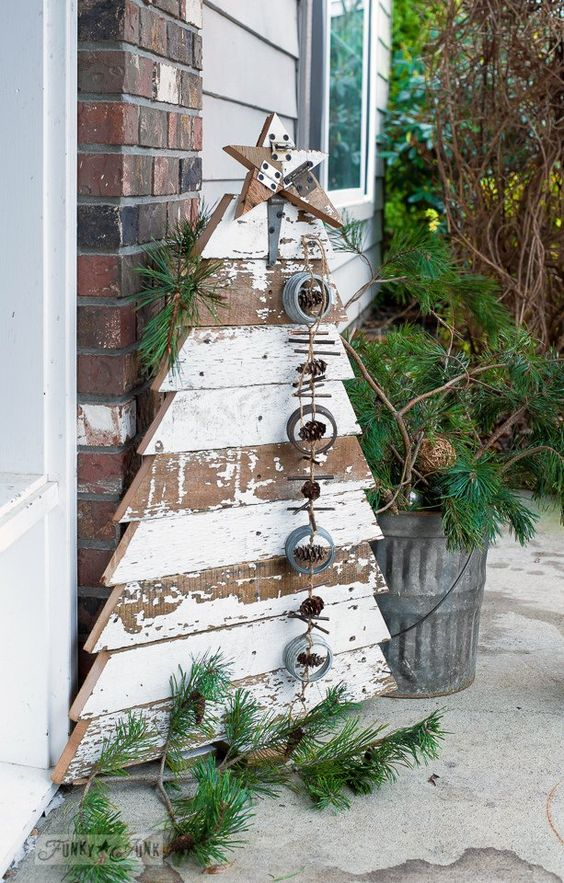 shabby chic pallet tree with a garland of jar lids, pinecones and sticks